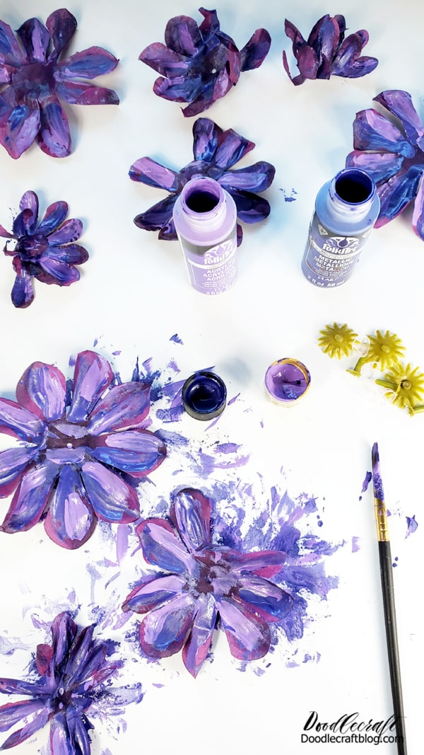 Repeat the painting for all the layers of silk flowers. Then let them dry completely. The paint will stiffen the silk petals a bit and actually make them lay better for the finished product.