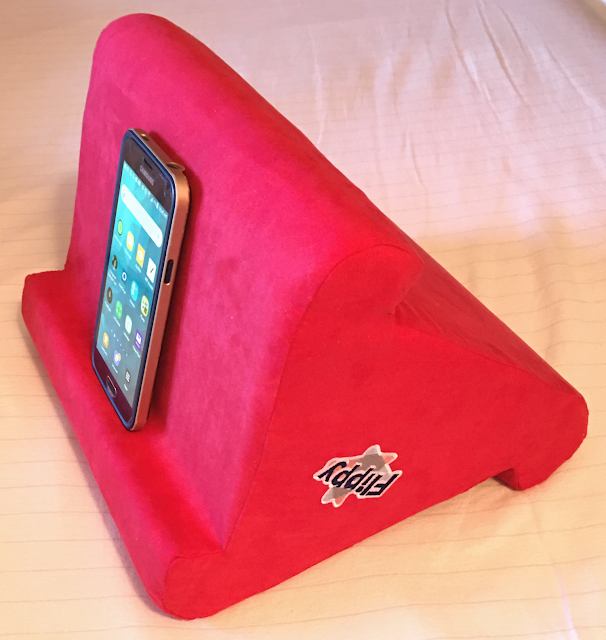 Photo of Samsung Galaxy smartphone at a 60-degree viewing angle on a Flippy pillow stand
