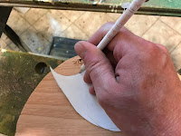 Tracing the template onto a piece of plywood