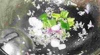 Stir frying onion , capsicum, garlic ginger for chilli mushroom recipe