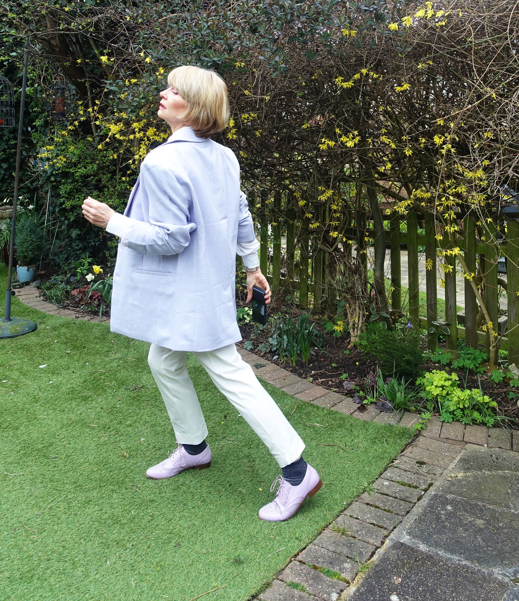 Pulling off an androgynous look over 50:  Is This Mutton blogger Gail Hanlon in lilac and white