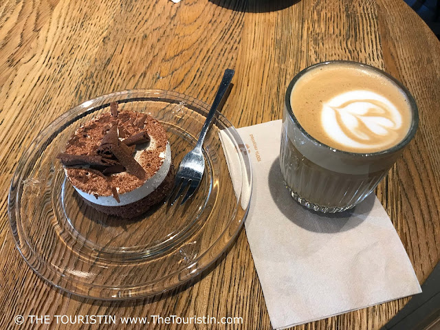 Flat White and cake at the Third Wave café Huracan Cafe in Vilnius in Lithuania