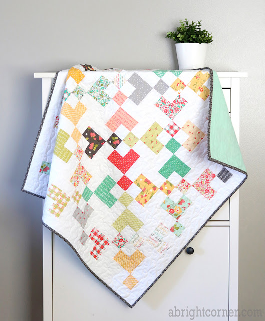 Sugar Cookie baby quilt by Andy of A Bright Corner - a charm pack quilt pattern from Perfect 5 Quilts book
