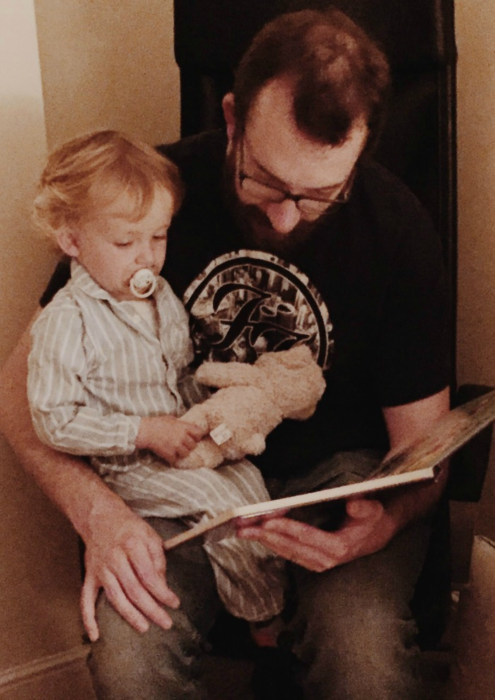 Squidge and daddy reading a bedtime story