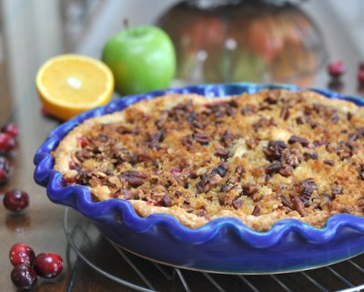 Cranberry Apple Pie (or Crisp) ♥ KitchenParade.com, tart cranberries, sweet apples and brandy-soaked currants with a streusel topping, bright with citrus and ginger.