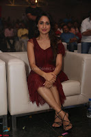 Pragya Jaiswal in Stunnign Deep neck Designer Maroon Dress at Nakshatram music launch ~ CelebesNext Celebrities Galleries 104.JPG