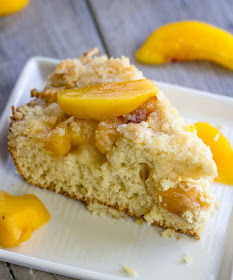 Slice of peach breakfast cake served with peach slices