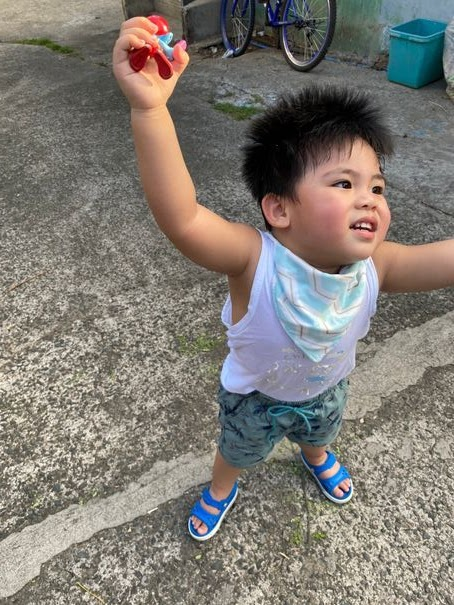 Happy toddler because he can have unlimited play or Unli Dapa