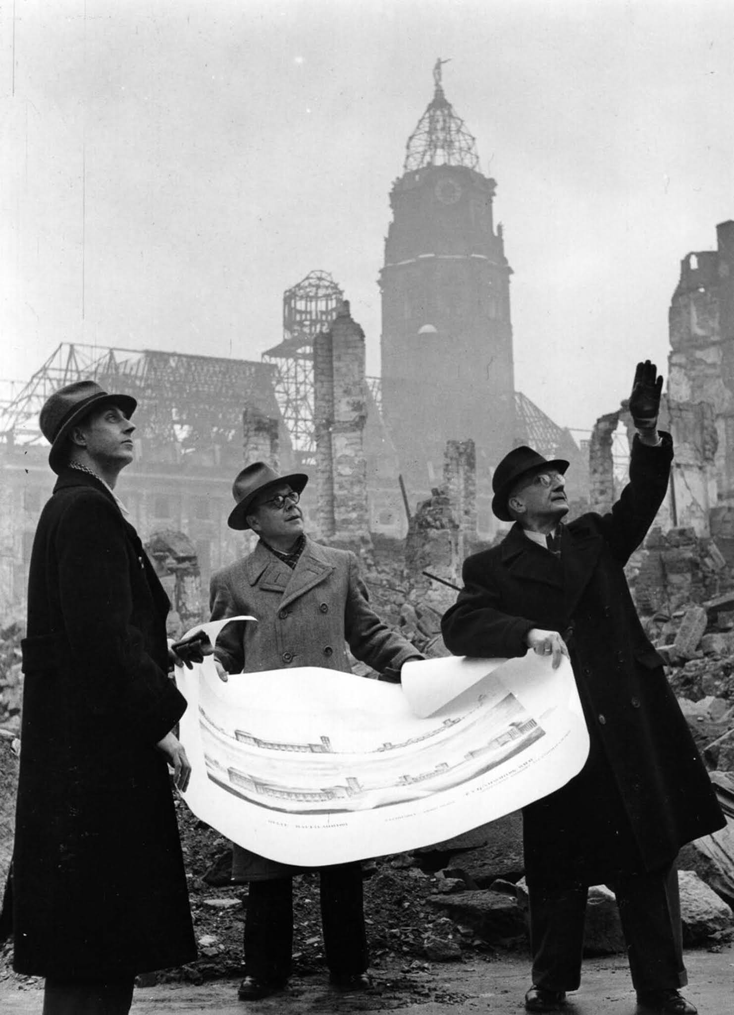 Propaganda director Heinz Grunewald, Mayor Walter Weidauer and architect Dr. C. Herbert discuss plans for rebuilding the city. 1946.