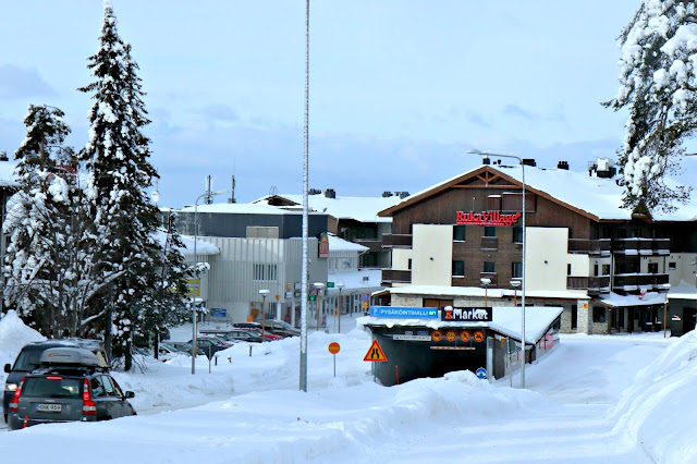 A very snowy entrance to Ruka Village, taken from up a hill.