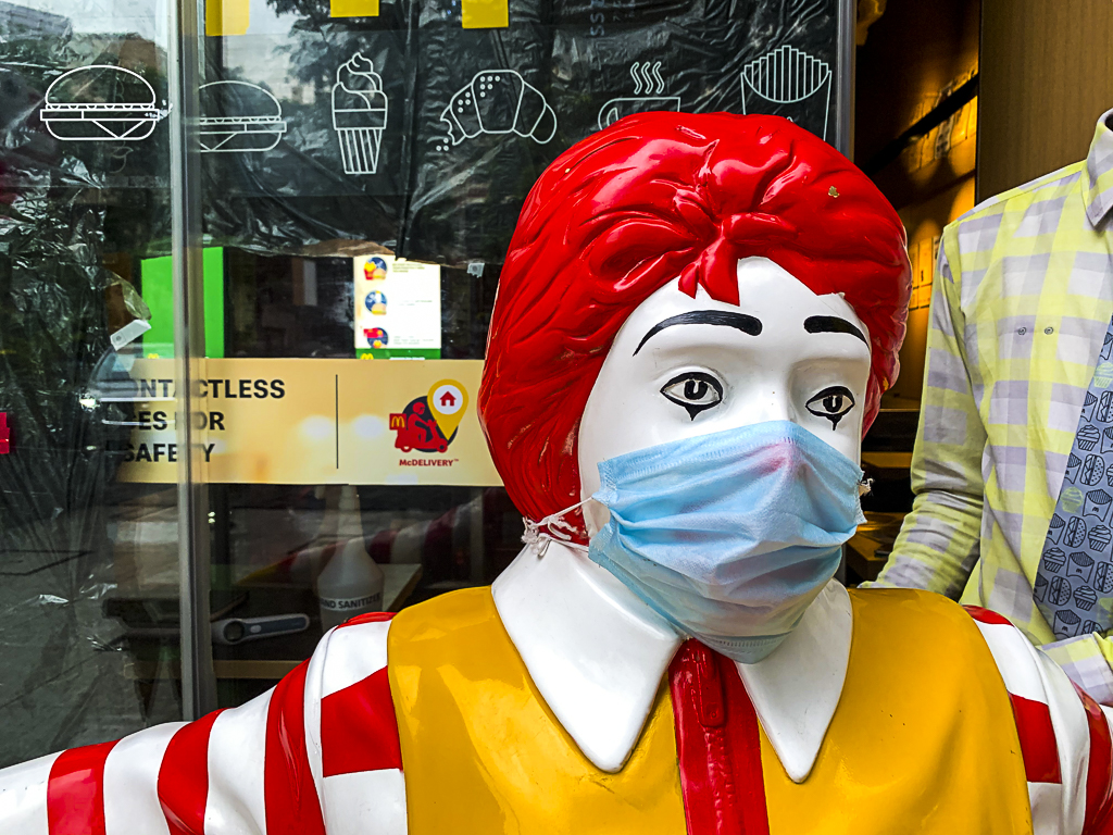Ronald Mcdonald wearing a mask