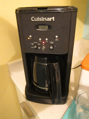 Image of a coffee maker with a clock reading 4:54 am