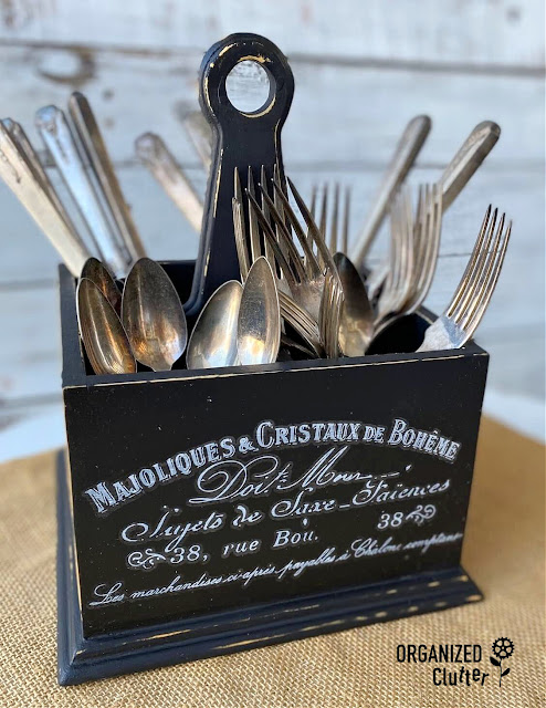 Photo of upcycled silverware caddy with vintage silverware inside.
