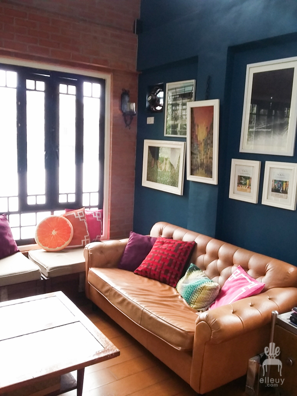 Brick walls, loft living room, high ceiling, wall of windows, vintage living room, navy blue walls