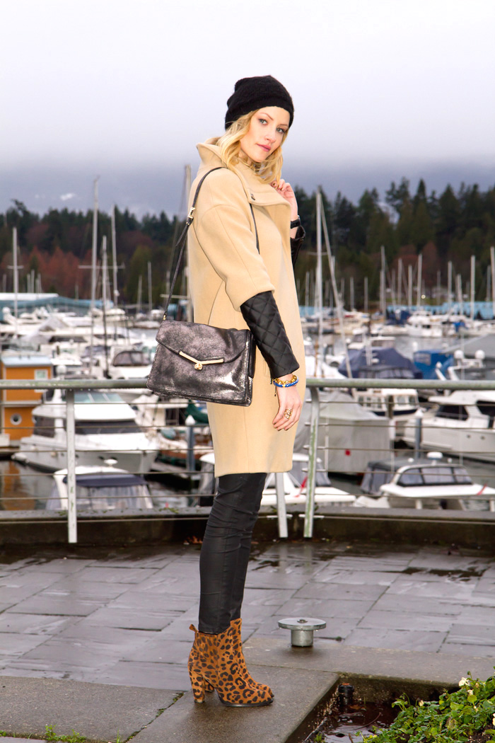 Vancouver Fashion Blogger, Alison Hutchinson, wearing Zara camel coat with leather sleeves, Zara black wax coated denim, Zara leopard print boots, Botkier silver treated leather bag, Stella and Dot renegade cluster bracelet, True Worth Design bronze bead bracelet, J Crew blue and gold bangle, Olivia Solie Jewelry triangle necklace