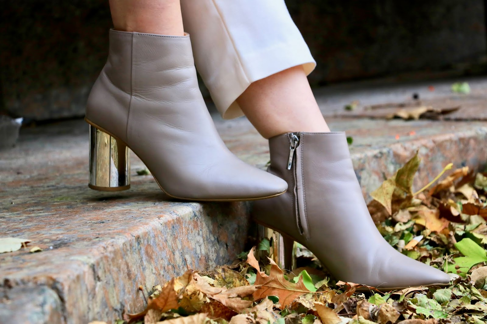 Nyc fashion influencer Kathleen Harper wearing nude Zara booties with a metallic heel.