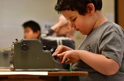 Nikola Adams types words on his Braille machine, like a Braille version of a spelling bee during the CSDB hosted Braille Challenge January 15, 2020.