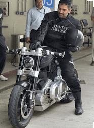 Image of Dhoni riding bike