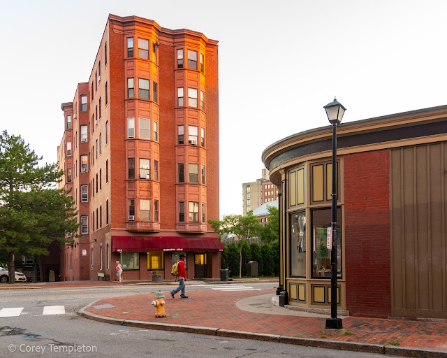 Portland, Maine August 2021 photo by Corey Templeton. Walking past Burnham Arms, a six-story apartment building on Congress Street that dates back to 1903.