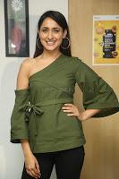 Pragya Jaiswal in a single Sleeves Off Shoulder Green Top Black Leggings promoting JJN Movie at Radio City 10.08.2017 091.JPG