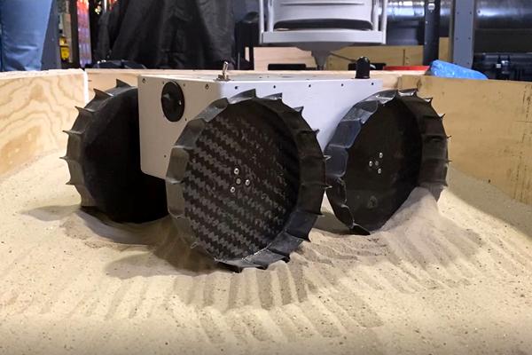 The Iris Rover undergoes testing inside a sandbox at Carnegie Mellon University in Pittsburgh, Pennsylvania.