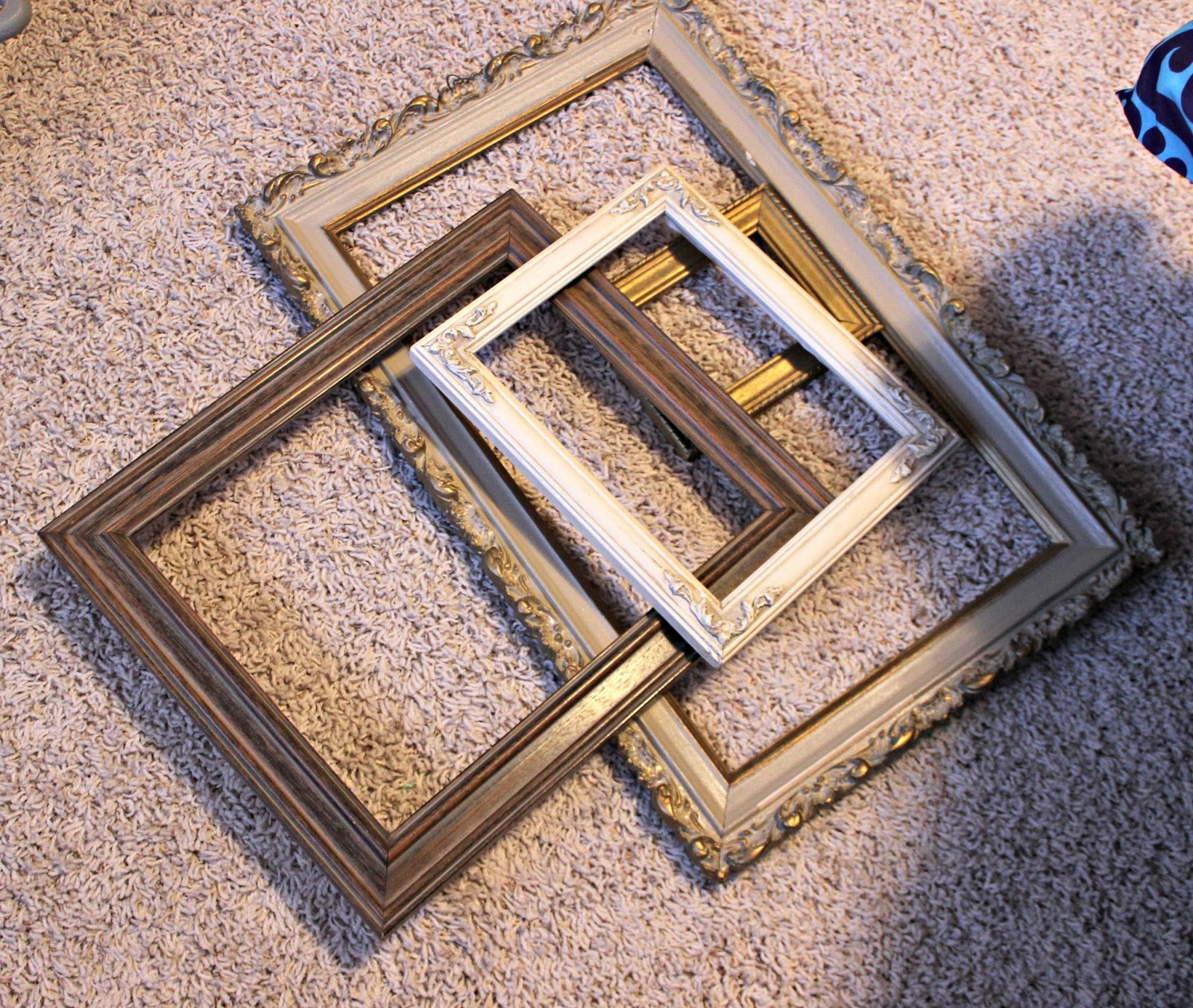 my christmas project today starts with this pile of thrift shop frames the sizes are measured from outside edges 12 x 10 14 x 17 17 x 24