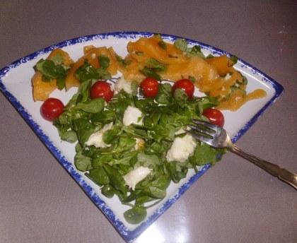 Summer salad mozzarella, basil, melon and tomato