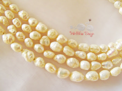 Closeup of Multistrand Pearl Necklace by WireBliss