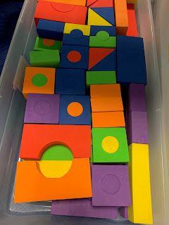 large plastic bin filled with soft colorful blocks