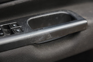 Photo of VW Golf Mk4 driver's door handle wearing badly