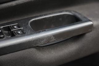 Photo of VW Golf Mk4 driver's door handle wearing badly