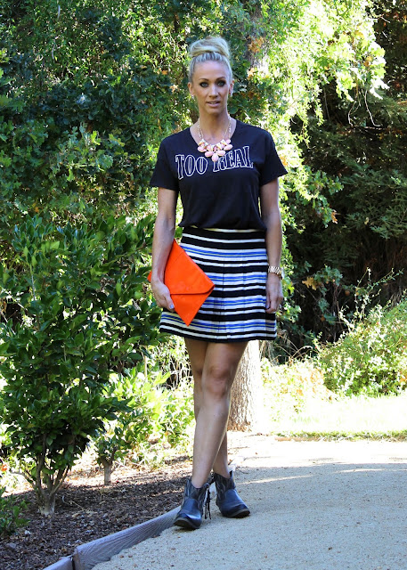 striped mini skirt with booties oversized clutch