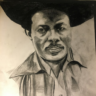 The cover is a pencil or charcoal drawing of I-Roy in a large hat and collared shirt.