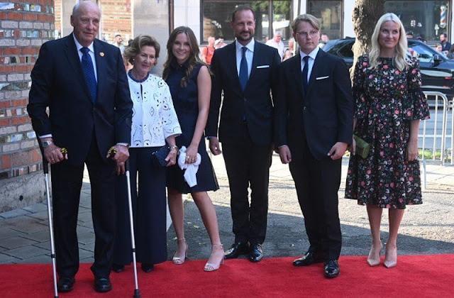 Crown Princess Mette Marit wore an aleena floral print matelasse dress by Erdem. Queen Sonja and Princess Ingrid Alexandra