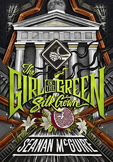 """Grecian columns in a stylized view of a car's engine, with a skeleton """"thumbs up"""" in the classic hitchhiking gesture. Half a pomegranate and some White Asphodel flowers are nestled below bright green letters reading """"THE GIRL IN THE GREEN SILK GOWN""""."""