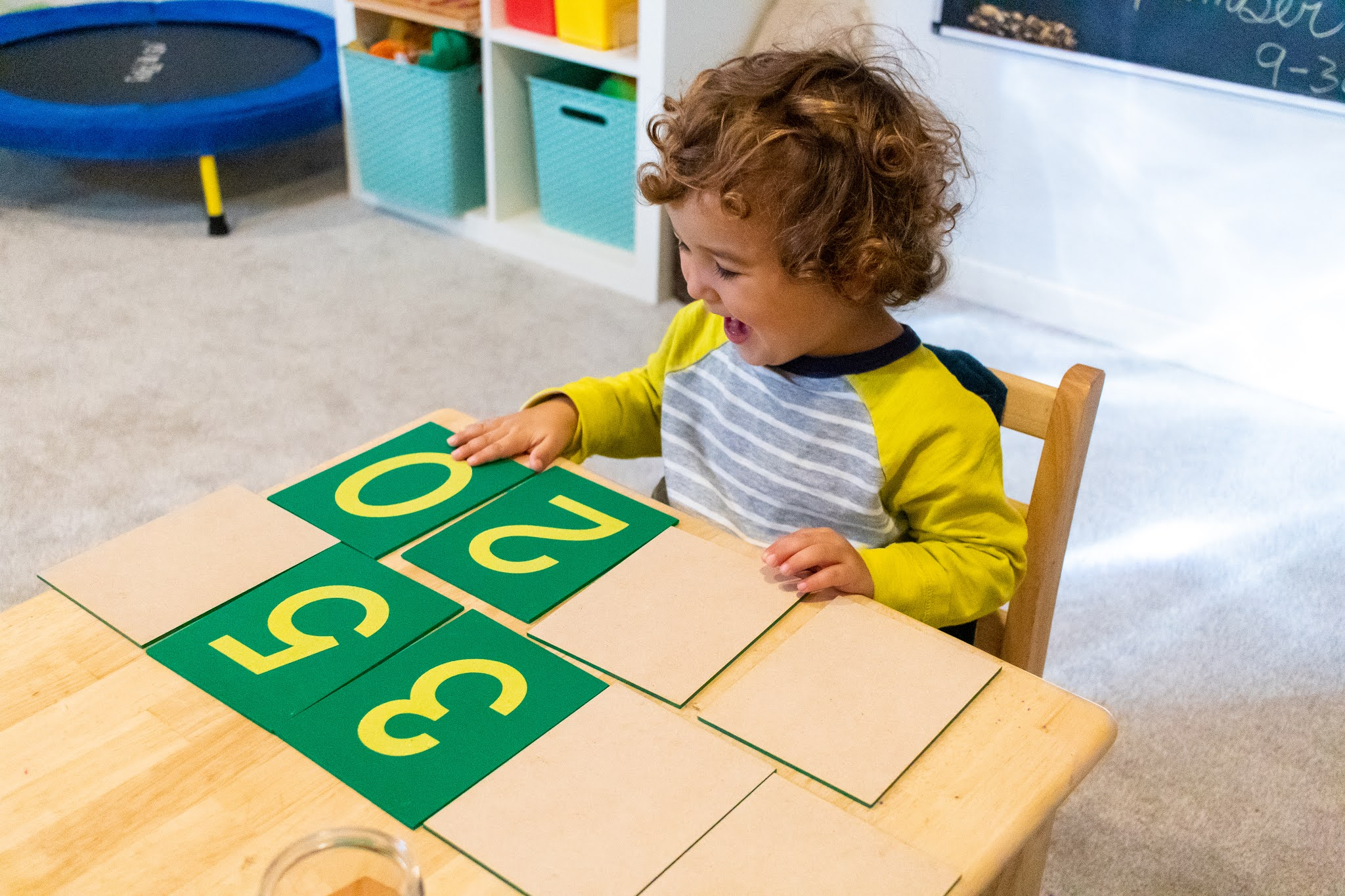 This simple Montessori friendly game is the perfect activity for Montessori letter and number learning with sandpaper materials.