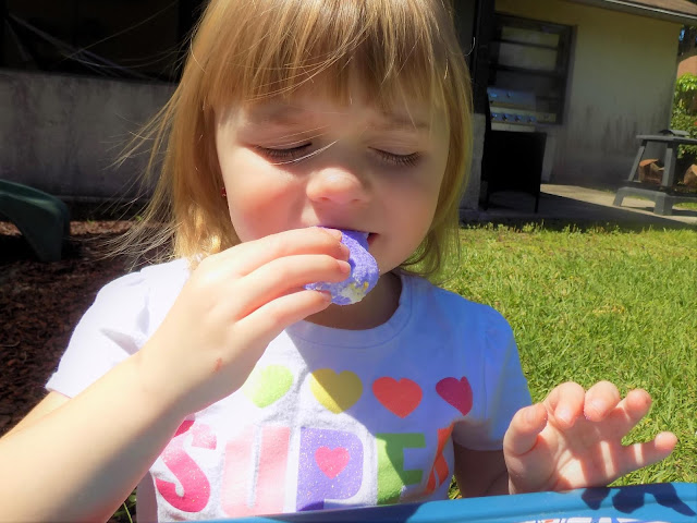 A picture of a child eating an Easter Bunny Car