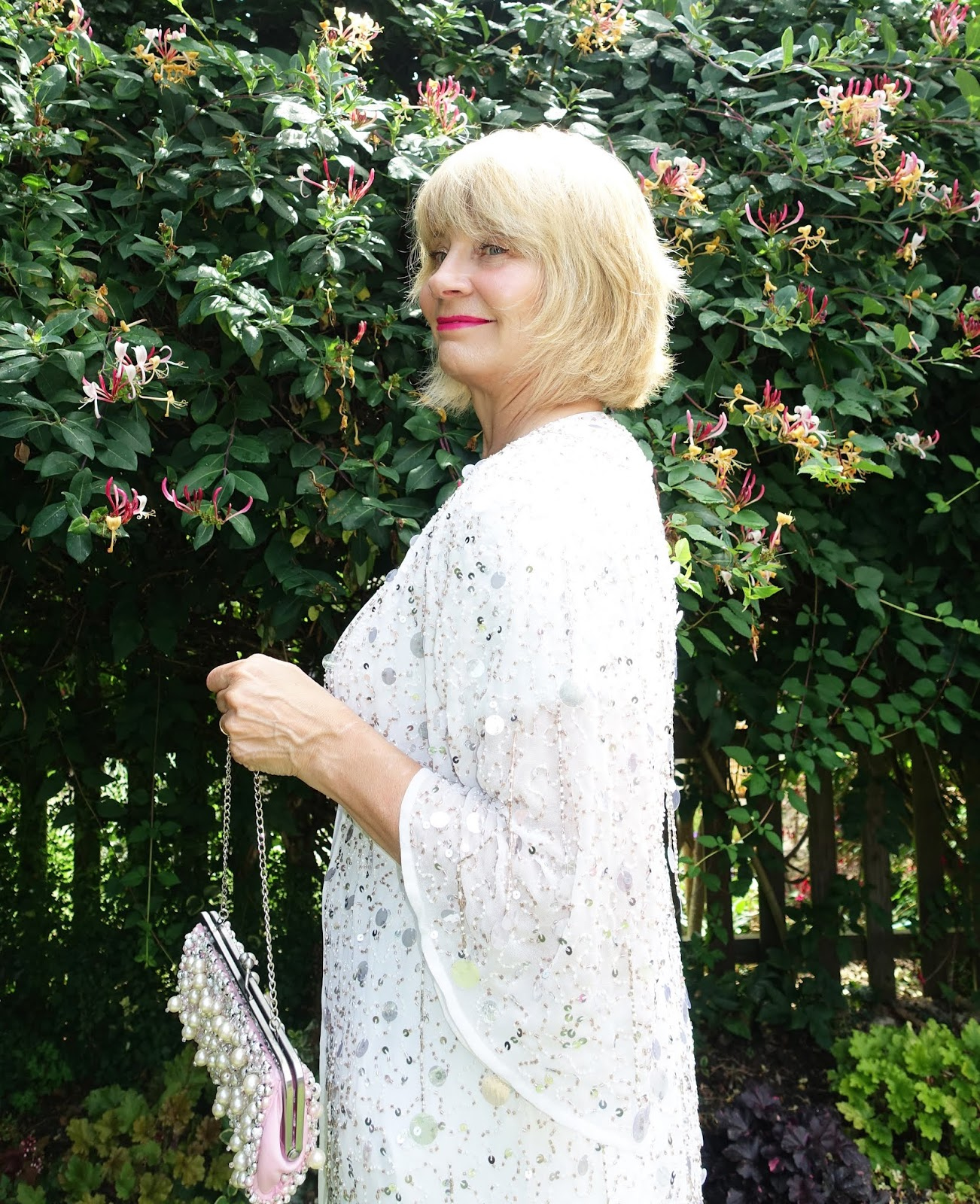 Long embellished white kimono worn with vibrant pink lipstick by over 50s blogger Gail Hanlon from Is This Mutton