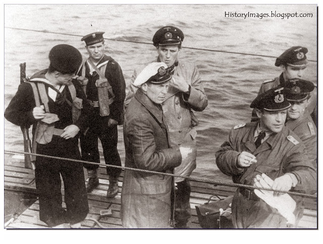 A German U-Boat crew surrender to Polish sailors at the British port of Portland The U-Boat captain is Lieutenant zur See Uwe Kock