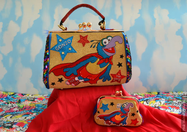 Irregular Choice Muppets Daredevil bag and purse with sky background and red cape