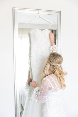 bride getting ready for her wedding dress