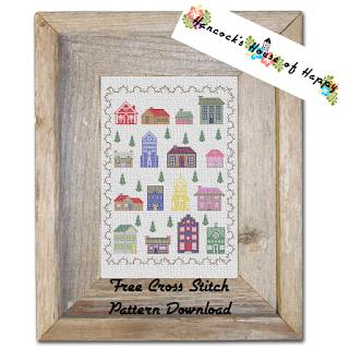 a modern cross stitch village sampler pattern