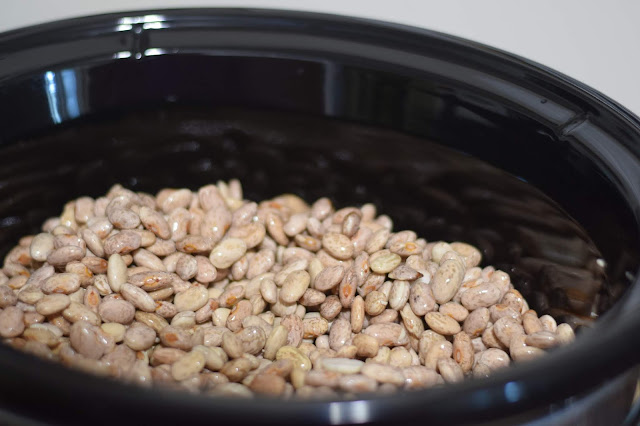The soaked pinto beans in the crockpot.