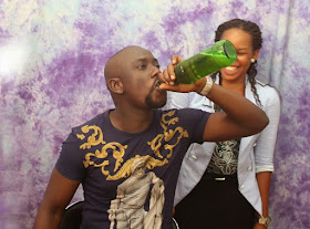 Man Takes A Bottle Of Beer In Front Of His Partner In Their Pre-wedding Photos.