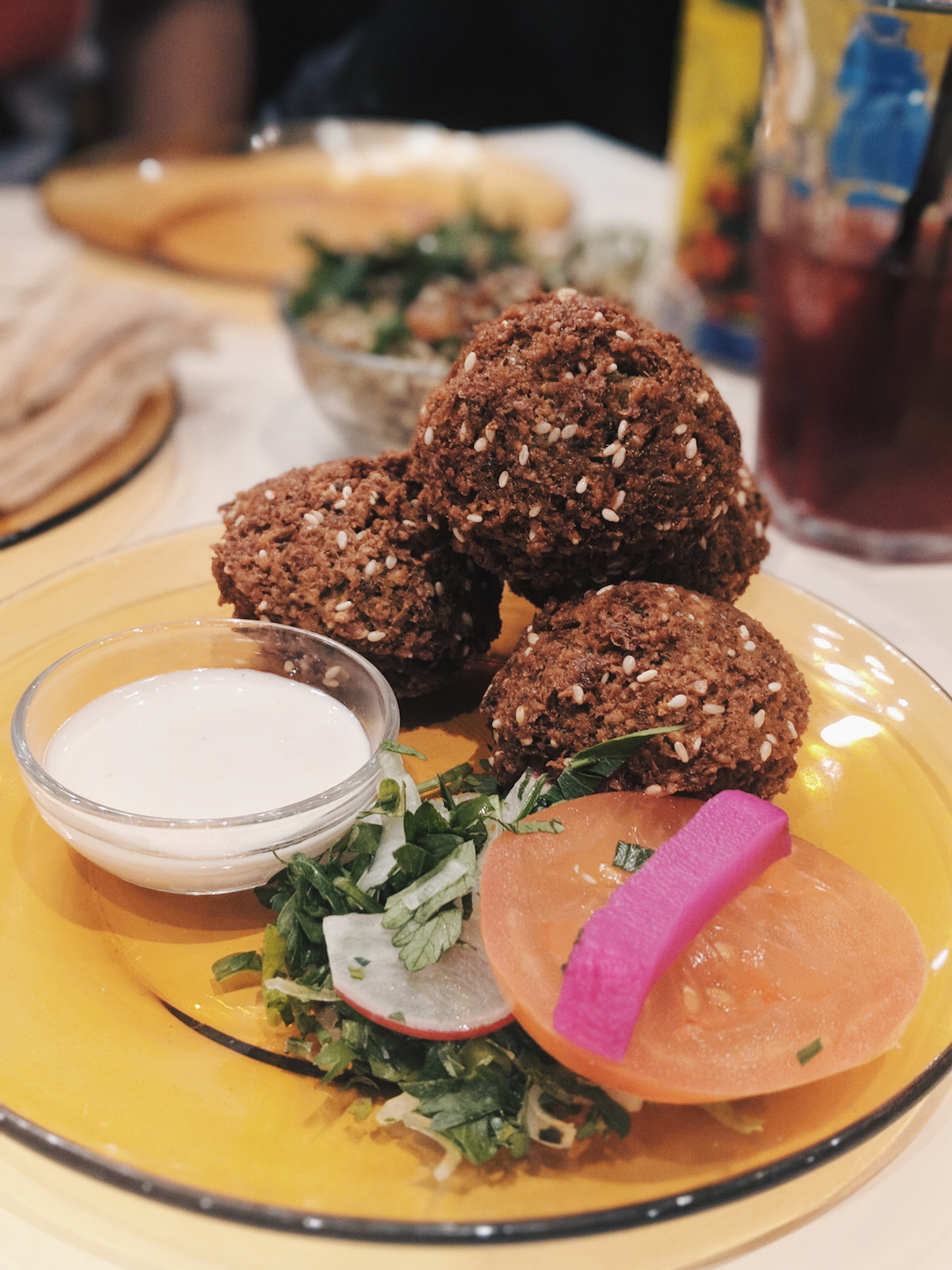 Four huge falafels with a tahini dipping sauce.