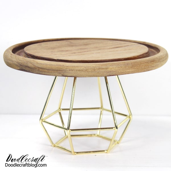 This darling cake stand would be great as part of the holiday decor...with a little Winter Wonderland set up on the stand and covered with the glass dome, like a snow globe!  Or, because the surface is food safe, you can fill it with cookies and other holiday goodies with no fear!