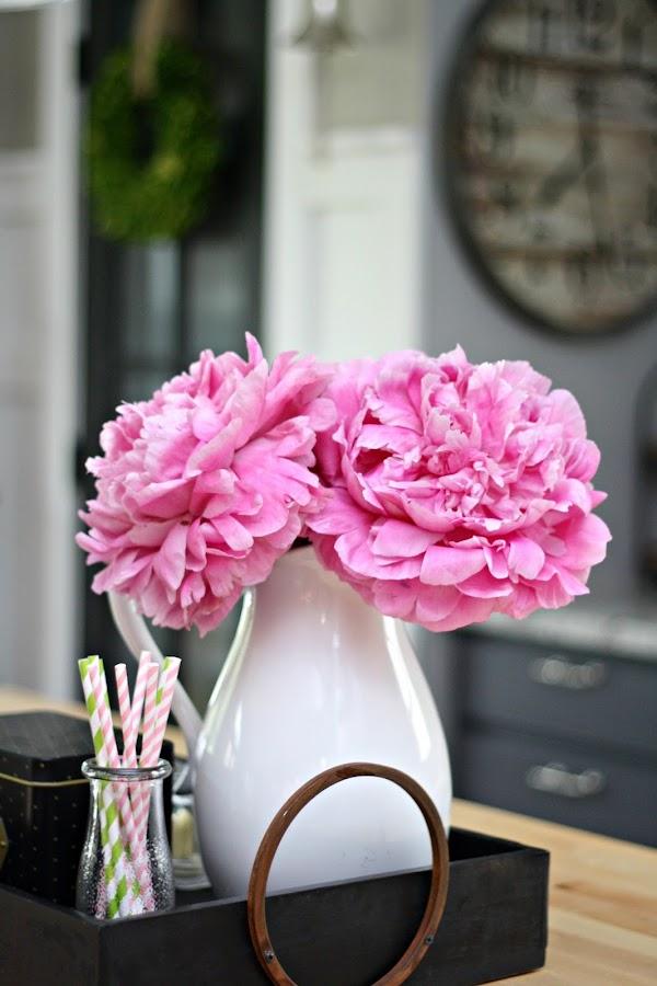 Pink peonies white vase