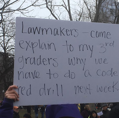 "Protest sign: ""Sawmakers - Come explain to my 3rd graders why we have to do a code red drill next week."