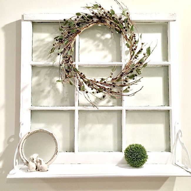 Old window turned into a decorative shelf