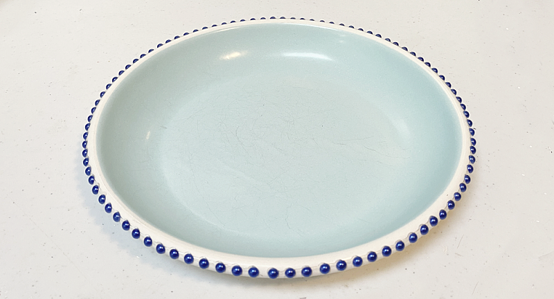 blue metal dish with beaded sticker trim
